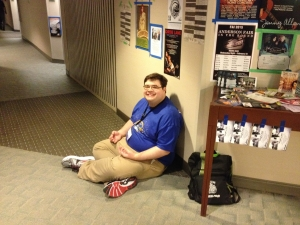 """Volunteers gettings some """"om"""" time in the hotel hallway."""